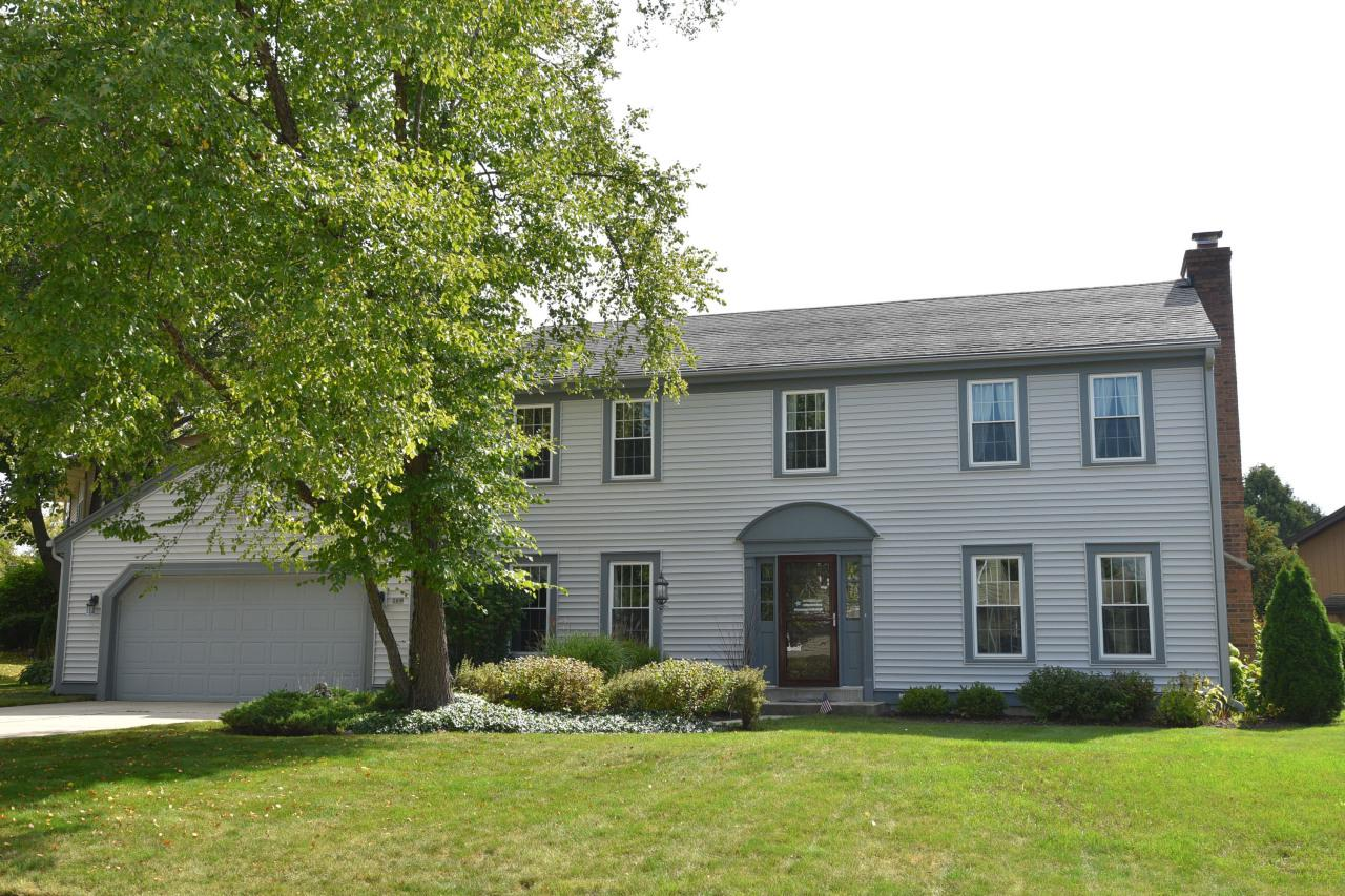 Located on just over a quarter acre on a quiet street sits this wonderful center entrance colonial. Great room concept perfect for family living. This is a must see home. Features of this expertly maintained home include a natural fireplace, completely remodeled kitchen, newer windows with lifetime warranty, newer furnace, newer hot water heater and more. Huge master bedroom with walk in closet and private bath. Beautiful, rear yard with patio and extra deep 2.5 car attached garage.