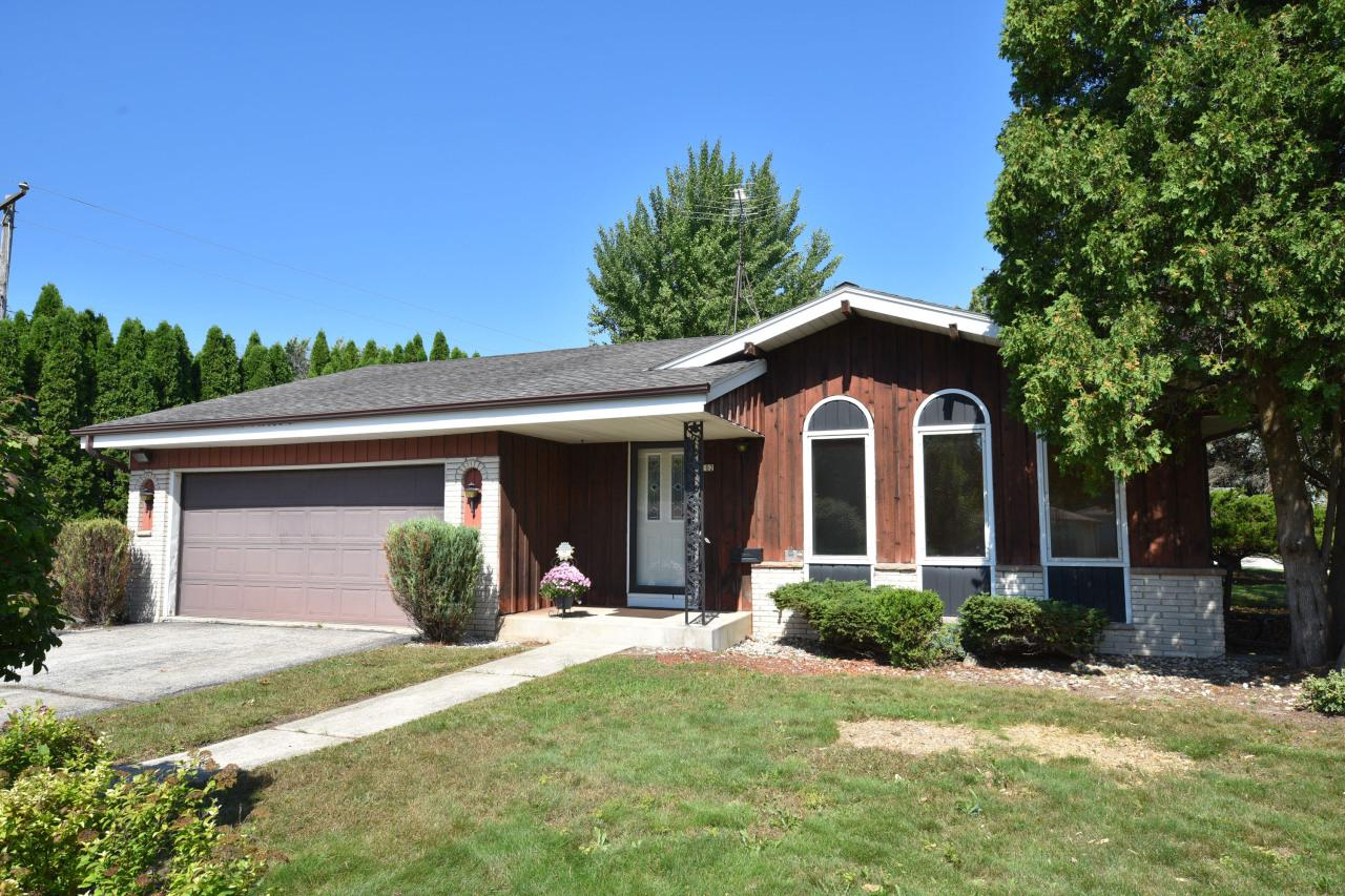 Looking for a ranch home with room to grow? Check out this 4 bedroom, 1.5 bath ranch on a nice size 1/3 of an acre corner lot. The 4th bedroom has potential for a first-floor laundry or den, but could be converted back to a dining room. There is an egress window in the lower level creating an opportunity for yet another bedroom. You will enjoy the private back patio, surrounded by mature trees. Or stay warm and cozy on colder nights in the family room around your NFP. Bring your decorating ideas to make this wonderful ranch home your own today!