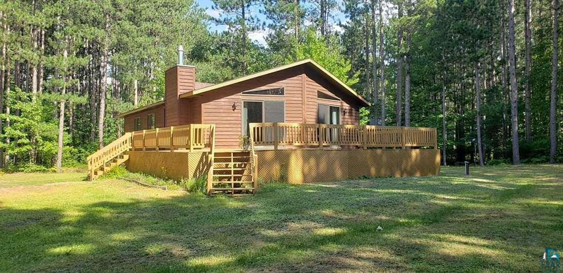 You don't want to miss the chance to own this impressive raised ranch home ,built is 2001 & tucked away in the towering pine trees of Brule.  If multiple bedrooms and bathrooms is a necessity, then this home is for you! Offering a master suite, 2 bedrooms, full bath, and laundry all on the main floor. The basement has 3 more rooms 1 bedroom & 2 noncompliant bedrooms all with closets. Plus a large rec room. There are large 2x2 ceramic tile though out the high traffic areas and new carpet everywhere else. You can snuggle up to the gas fireplace in the winter, and enjoy the sunshine on the large deck & central air in the summer. Now you can complete the package with a 3 car garage and large yard.  Enjoy all the amenities Brule has to offer, the Brule River, ball fields, restaurants, bank, gas stations, post office, etc.  Brule has it all just 30 minutes from Superior!