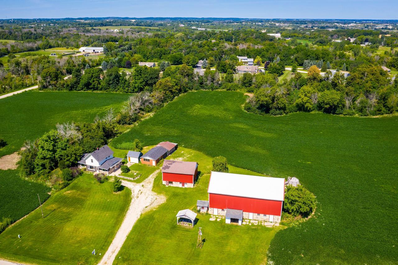 HOBBY FARM IN AWESOME RICHFIELD LOCATION ACROSS FROM KETTLE HILLS GOLF COURSE! 4 OUTBUILDINGS INCLUDING 2 BARNS, GARAGE, SHED & FARMHOUSE ON 19 ACRES! Updated Main Barn with Newer Steel Siding and Metal Roof Hosted A Family Wedding, Small Barn with Steel Siding, Masonry 2 Car Garage with Overhead Door and Additional Shop Area, 1900's Farmhouse Needs Cosmetic Updates with 5 Bedrooms, Living Room, Kitchen, Family Room, Office and Main Level Laundry Room, Land Is Tillable, Horses and Livestock Allowed...BEAUTIFUL RICHFIELD PROPERTY & SETTING!