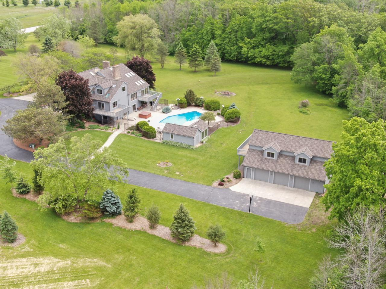 Quality Keshemberg built private 5.2 ac multi-level estate, w/ vaulted ceilings & skylights. Perfect for entertaining!Main level master suite includes master bath, spa tub, steam room shower. Showcase Atrium, updated sun-drenched granite kitchen, dining room, 2 fireplaces, lst floor laundry, wooded views overlooking inground pool & poolhouse. Upper level 3 bedrooms & large bonus room w/ wet bar. Walkout lower level with office, full bath, exercise room, sauna, rec room, wet bar, workshop/storage room, fireplace. Separate 3+ garage, storage, loft w/possible future living space.In-ground heated 20x40 pool & separate hot tub. Pool house with heat, full bath, sitting area, changing room, wet bar.A must-see property! Convenient shopping, 20 min downtown & 30 min airport. HSA Home wa