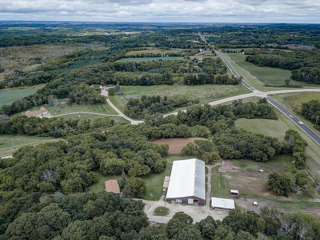 Right in time to fill the barns before winter! Don't miss your opportunity to own your own equine facility in the Holy Hill area! 28 stall barn with viewing lounge, tack rooms, and half bath adjoins Indoor riding arena! Outdoor riding arena and fenced paddocks with shelters too. Plus two more sheds for equipments/storage. Over 16 private acres of rolling Kettle Moraine near spectacular horseback riding trails in Loew Lake Unit. Simple, yet updated, open-concept three-bedroom home with full basement in move-in condition. Great visibility on the corner of Cty Hwy K and 167/Holy Hill Road makes marketing, clinics and/or events easy. This property is perfect for all your many hoofed friends or a great start for your boarding barn-at an affordable price. Don't miss it!
