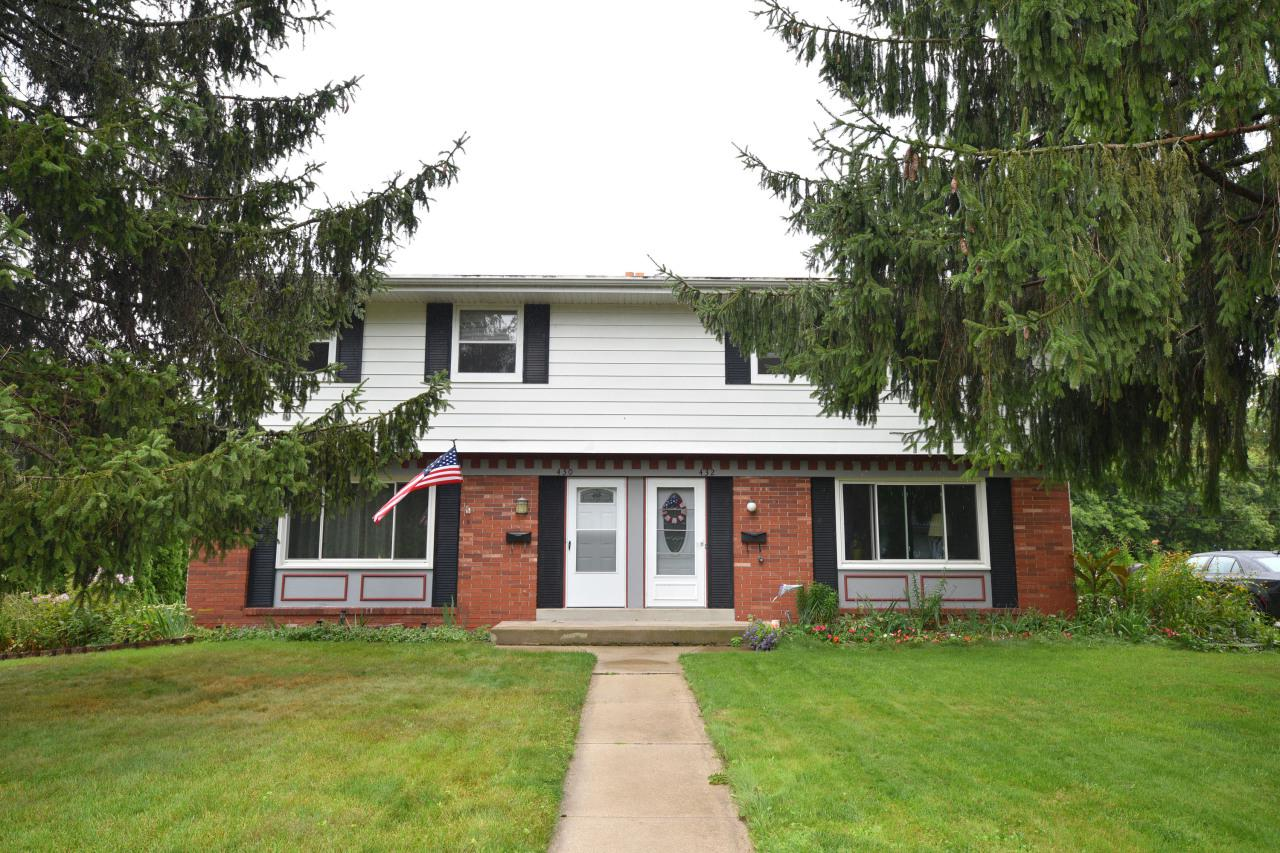 Fresh, clean condominium on Main Street in Saukville. Three bedroom, bath and one half, newly carpeted, freshly painted,  Updated kitchen with Corian counter tops, tile backsplash, new flooring and newer appliances. All this and tons of storage, too. Full basement, also neat and clean, with a bar and laundry room. New windows on main level. Storage shed and swing set also included. Move right in and enjoy. No condo fees, pets allowed!