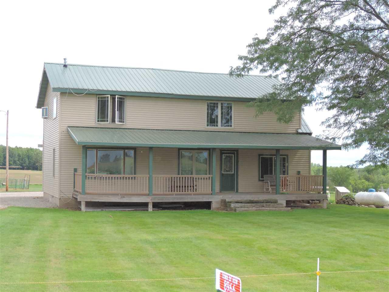 Horse lovers dream, approx 67 acres of land, fenced in pastures, horse barn with indoor arena, newer 40x60 work shop with 3 overhead doors, outdoor riding area, approx 40 acres of agricultural land. Lower level of home is currently gutted and can be finished to make it your own.