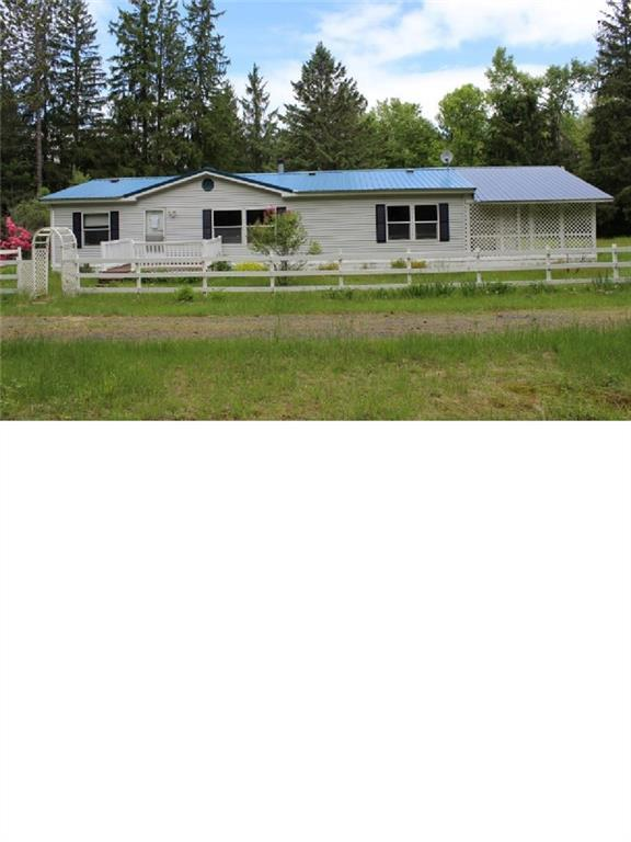 View this Ranch style manufactured home with 3 Bedrooms, 2 Baths and approximately 1560 square feet of living space.  Features Living room w/FP, separate Dining room, Kitchen with plenty of cabinet and counter space, Master in-suite bath with whirlpool tub, enclosed rear Sun room, front porch and covered patio.  Situated on approximately 5 acres of land this home has lots of potential. Property is lender-owned, is being sold ?as-is? and the Seller is making no representations or warranties.
