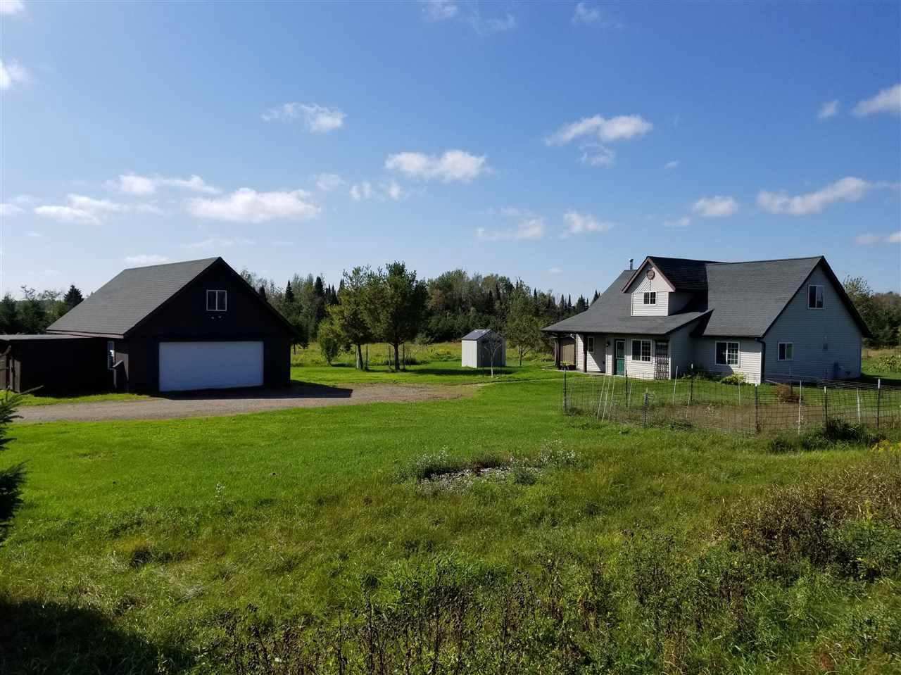 Looking for an affordable opportunity to Homestead on 36 of your very own?  Raise chickens and dogs, goats, horses or beef cattle?  This is definitely the opportunity you've been looking for that rarely comes available in the gorgeous Town of Pine River countryside.  Sellers have planted 20 fruit trees, including pear, plum & Cherry, oaks and maples and the chicken coop is included. This is an easily commutable location for those working in Merrill, Wausau or Antigo.  It's move-in ready, let's get you Home!,While the home does not have a basement, the 24x36 garage/workshop has a walk up area for storage, or could be finished off.  The whole house has radiant in-floor heat installed and former owner used an LP Boiler to heat the home.  Current sellers disconnected the boiler and use a pellet stove instead, averaging $1000/year in heating costs.  The 320 gallon LP near the garage is also currently disconnected, but is owned and will stay with the home.  The gun safe in the Master Bedroom is also staying.  Jetted tub is currently not hooked up, but would just need to be re-connected.  Seller's worked from home in the web development industry and use fixed wireless high speed internet through Airnet.