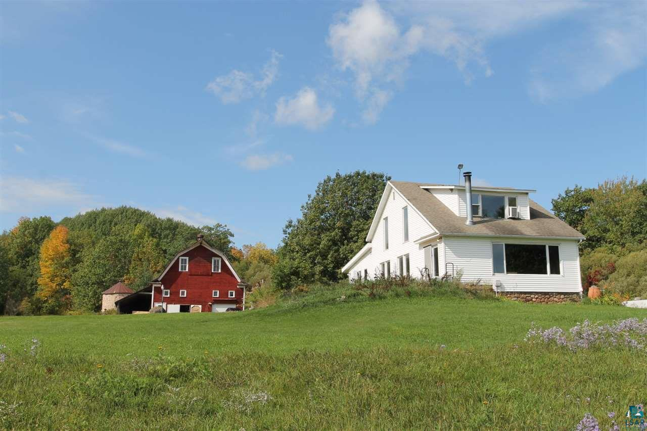 Truly a one of a kind property in Bayfield, WI.  Turn of century farmhouse and barn with Lake Superior frontage.  Approximately 29 acres with panoramic Lake Superior views.  Original barn with Rock Silo.  Apple orchard and trail access to the sand beach.  Home features 3 bedrooms, 1 1/2 baths.  The opportunities for this property are endless.