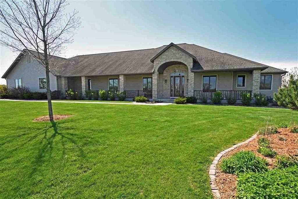 """Beautiful sprawling property on a quiet country road, in the Town of Oregon! 78 Acres. Currently a Horse Farm. Original Owner. Built in 2004. Gated Entrance, Ranch style home, 5022 finished sq ft, 4+Bedrooms, 4.5 Baths, 2 Fireplaces, Spacious rooms, Upgrades Galore, Screen Porch, Deck, Exp. Walkout lower level, Patio, 3+ Car Garage Attached, 180x100 Horse Barn with 7 Box Stalls, Heated & A/C Tack room, Lounge/Viewing area, Bathroom, Arena, and More. 80x50 Hay Barn, Lean too's, Fenced Pastures, Tillable land, Additional Home (40x26), Detached 2 Car Garage, Views for Miles! 3 Additional homesites per Dane County, *See """"Docs"""" for much more info!"""