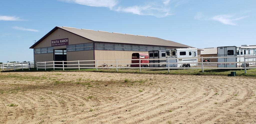 Dream of owning a horse ranch training facility...barn constructed in 2002 features a 64X104 (14'side walls) indoor riding arena w/ insulated ceiling & viewing room, 5 wash stalls (8X8), 17 lockers (saddle & brindle racks), 4 tack rooms, and bath with in floor heat through out. 20 stables (12X12) which are all matted (sand, gravel compact underlay) w/self grain feeder, 200 bale hay storage, feed/storage room leading to 6 private paddocks w/ high tinsel covered wired boundaries separated by tape fencing.,Barn does have its own LP tank and holding tank, and hydrants. Outdoor riding arena & plenty of parking...seller currently board for $425 per month.  Now let's talk about the house...this 4 bdrm 2 bath home needs some updating here and there, but that's not the whole story....during our summer storms a tree fell on the garage, breezeway, and scratched the current metal roof.  Well the seller has settled with the insurance company for a new 24X24 attached garage (including new concrete slab) a new 8X12 breezeway and a new shingled roof to the tune of $34,100....all this to be completed by licensed contractor prior to closing!  The seller has enjoyed every moment on this 20 acre ranch now it is time to pass on her dream from one horse lover to another!  Additional 20 acres can be purchased with property for a total of $299,900