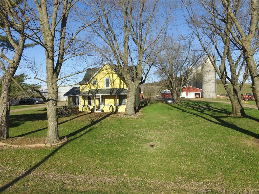 5 bed, 2 bath home on 230+/- acres just minutes from New Auburn and only 30 minutes to Eau Claire.  This property features a large home with large kitchen, dining room, family room and bedrooms.  36X150 free stall barn, 54x88 heated work shop with attached 54X80 free stall/machine storage (Electricity to all buildings), large feed lot.  175+/- acres of tillable land and 35 acres of pasture, with remainder in woods.  Perfect setup for horses and or cows.  Outdoor wood burner.