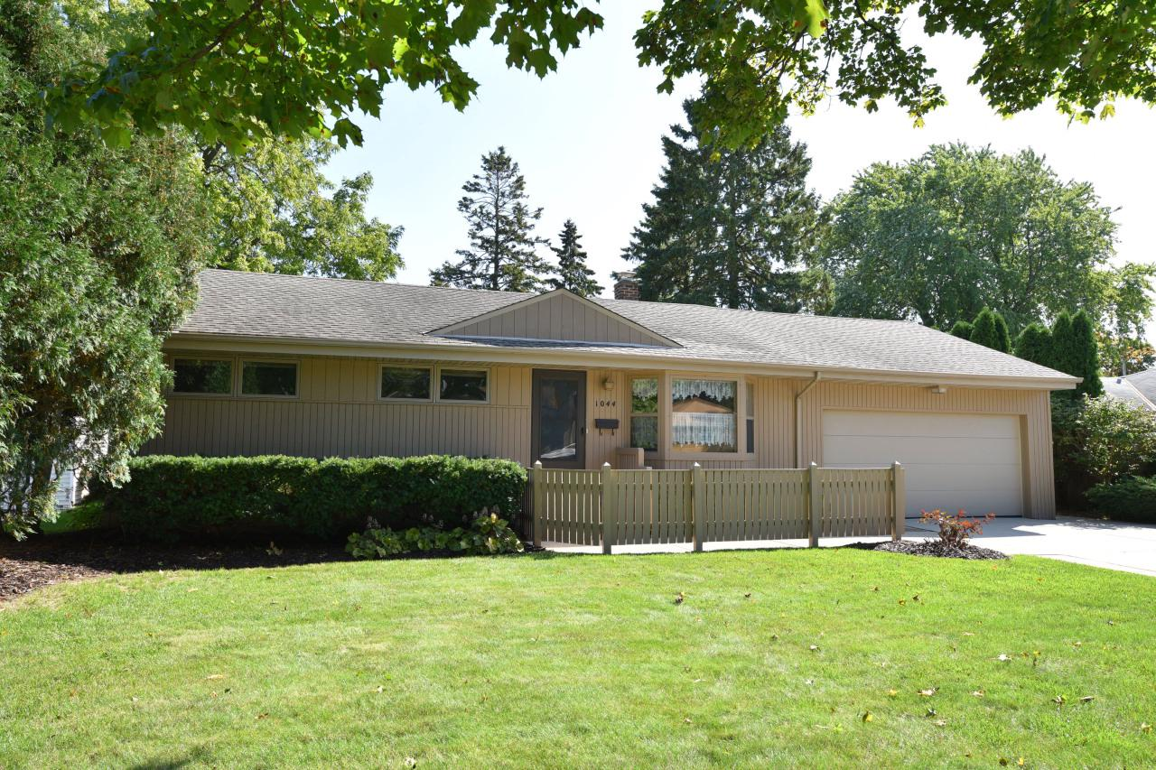 A one-owner sprawling 1,862 square foot (above grade) ranch home with three full bathrooms! The kitchen features raised custom paneled cabinetry, sprawling counters, and a handy pass-through to the formal dining room. Enjoy relaxing in the inviting family room featuring a beamed ceiling and a center fireplace for an attractive focal point. Hardwood flooring in several rooms; and tons of closets throughout! Large lower level rec room boasts a built-in electric fireplace, along with a private den/office, plus a full bathroom! Relax on the sprawling deck overlooking the gorgeous backyard with tons of perennials. Updated electrical service in 2019. Close to parks, shopping, restaurants and more! 12 Month HSA Home Warranty included.