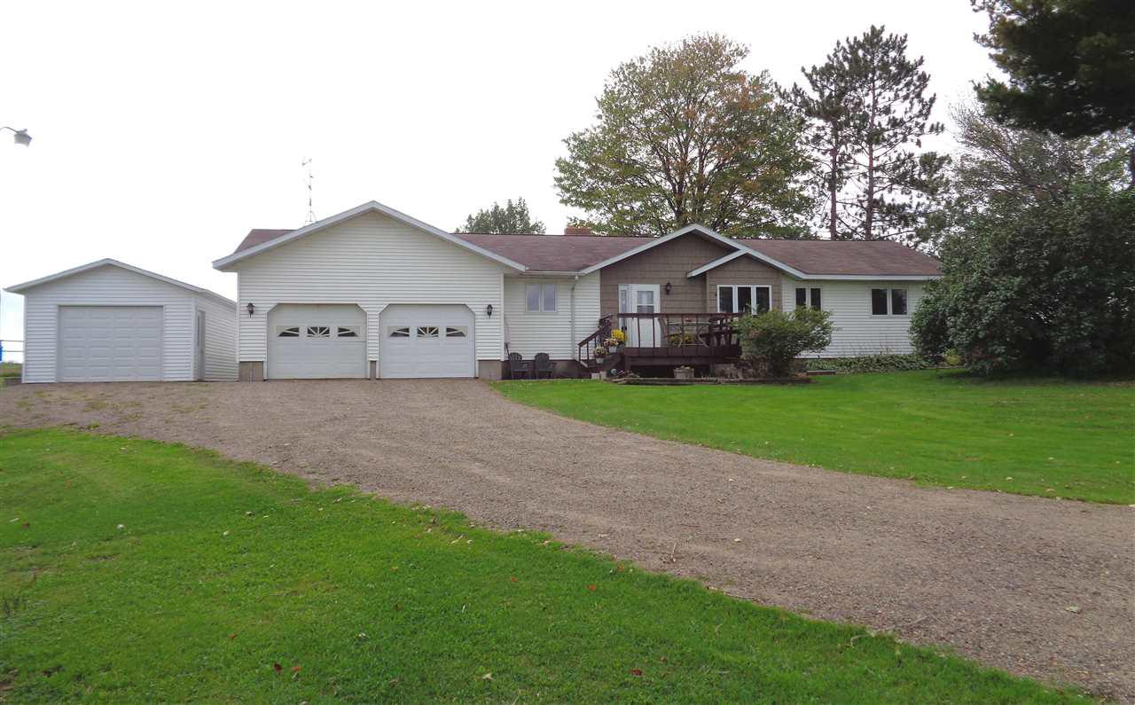 Solid 3 bedroom, 1.75 bathroom country ranch home located just 2.5 miles from Medford on a blacktop road. Custom oak kitchen with breakfast bar and large pantry. Dining room with built-in curio cabinet. Spacious living room with nice views. Master bedroom with walk-in closet and 3/4 bath with double sinks and main floor laundry. Poured concrete basement with built-in storage shelves, bar and bonus room. Two car attached garage is insulated and sheeted. Additional detached garage and two yard sheds. Nice yard. Horseshoe driveway. The refrigerator, stove, new dishwasher, washer, dryer and two yard sheds are included in the price.