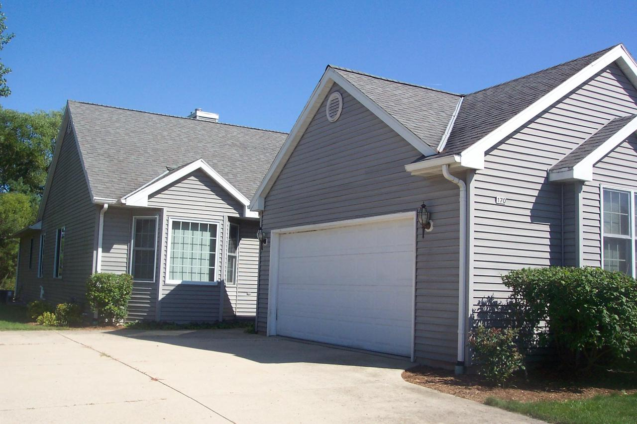 Quiet area on east side of Belgium. 2 bedroom 2 bath ranch condo.  All appliances Included.  Gas fireplace and patio doors in den area off kitchen. Deck with private area.Unfinished lower level with ingress/egress window and studded in for extra bath,.  Immediate occupancy. PETS ALLOWED----NO CONDO FEESSeller moved to a retirement home. Living room/dining room open concept area.