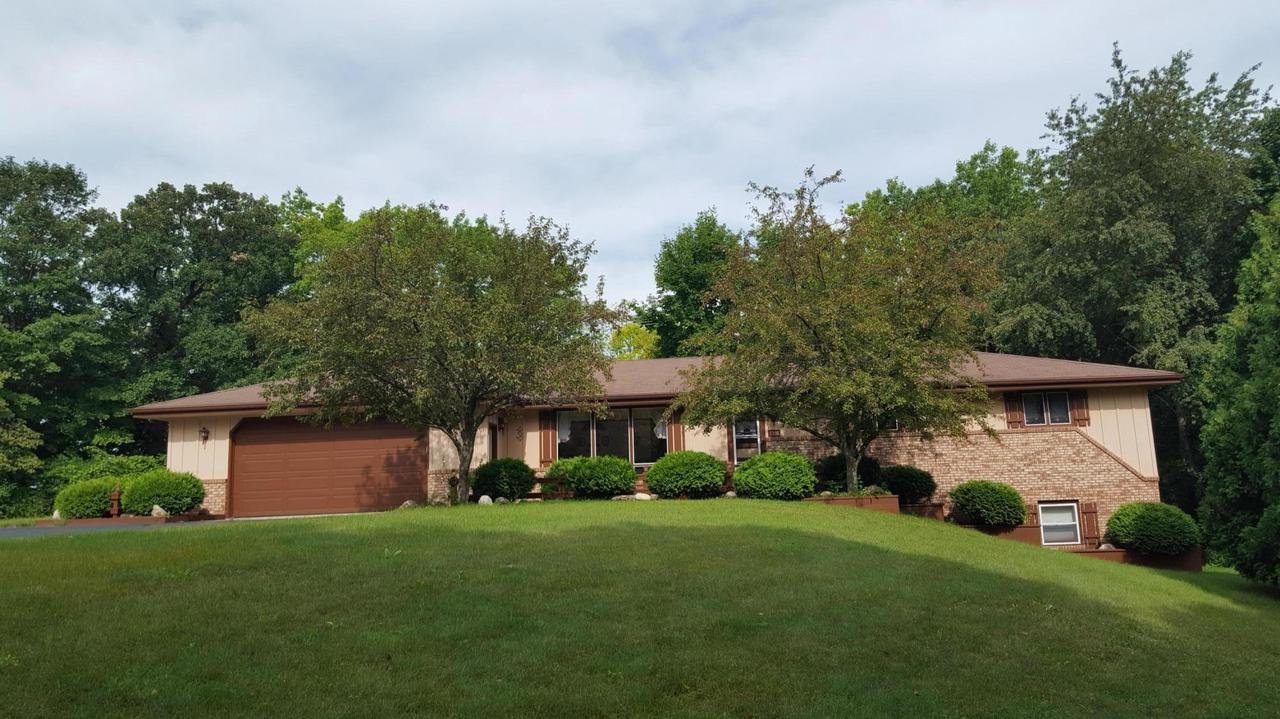 Private, wooded setting for this Ranch home, yet close to Hwy 41 for city commuters. Inviting living room with wood cathedral ceiling, spacious kitchen and dining area with patio doors to the backyard. Large bedrooms including a master suite with private bath. The lower level is partially exposed and features a huge finished family room with patio doors to the backyard. This area is suitable for a ''mother-in-law'' suite. There is a 1/2 bath on that level which could easily be turned into a full bath. The 3 car attached garage is uniquely arranged with a 2 car entry in the front and a 1 car entry on the side. All with 9 ft overhead doors. Very well maintained home and grounds.