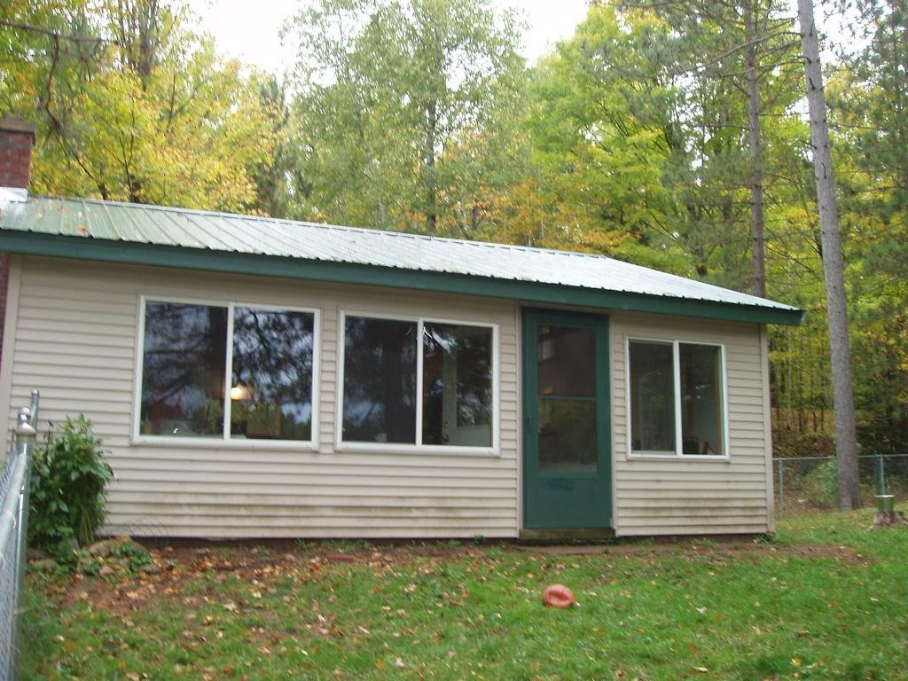 (261) Great water views can be enjoyed from this 24?x24? cabin that has been completely renovated. The cabin was originally built in 1952 but the owners have completely renovated the building down to the studs. Metal roof. Exterior has vinyl siding, all new vinyl windows. Walls and ceilings have been well insulated. Dry core flooring, vinyl flooring. Metal exterior doors. Cabin is wired for a generator which is included. Gas refrigerator and stove. LP gas space heater. There is a small storage shed, outhouse and an additional 12?x12? two story bunkhouse currently used as workshop/storage. Nicely wooded property with end of the road seclusion. Must see to appreciate this truly unique property. Priced to sell at $77,900. See it today. (27-40N-1E)