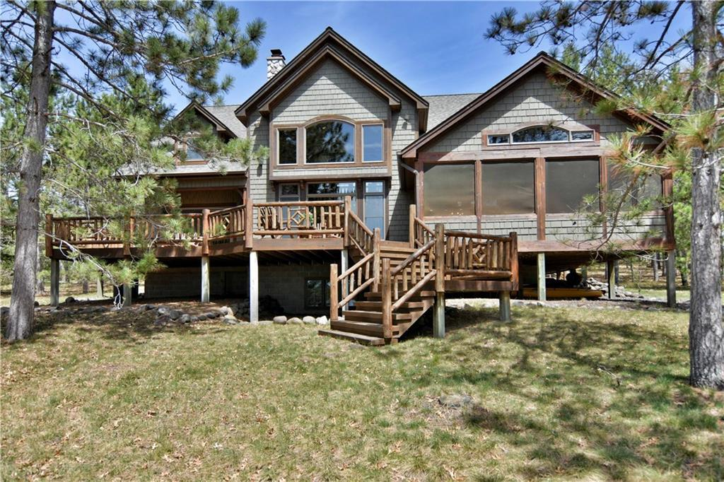 Spectacular luxury lake home in the Northwoods.  This well thought out home has a great open floor plan and three distinct levels of living. Well planned with great stonework and cozy areas throughout. In floor heat in all bathrooms/tiled areas, and in the lower level. A few of the features include a soaring great room, massive stone fireplaces, large screened in porch, covered and uncovered decks. The large detached garage has living quarters above. Completely cared for and constantly updated. Don?t forget Horseshoe Lake, a quality and sparkling clear lake. This has an easy walk to the sandy beachfront and level yard area for games.
