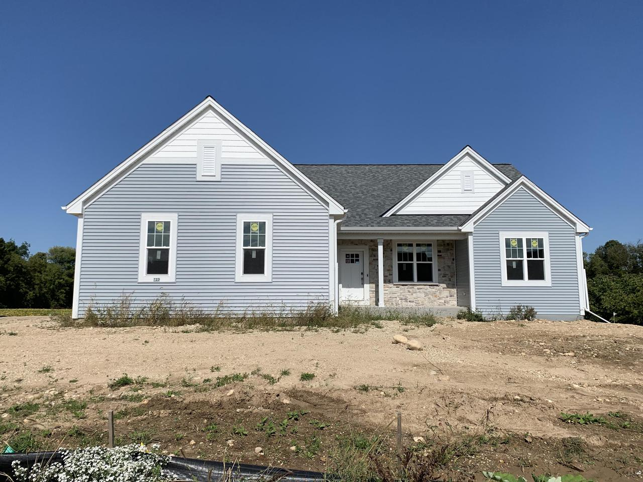 NEW CONSTRUCTION by Stepping Stone Homes. $2500 buyer closing cost credit OR credit towards a patio/deck for an accepted offer by 10/31! The Ellington model, offers a split BR design, beautiful dinette w/large window off the kitchen, & a huge basement w/full sized windows, perfect for adding another BR, or more living space.  Open concept with lots of upgrades like soft close dovetail cabinetry, quartz/marble counter tops, double sinks in the bathrooms, upgraded flooring, 8 ft GA doors & more! First FL laundry, electric fireplace, this home has it all. And don't forget the Smart Home Technology including integrated lighting, door locks, ecobee smart thermostat, video doorbell, Lift Master garage door & Samsung Connected Touch Screen Family Hub Refrigerator. Driveway & seeded lawn included.