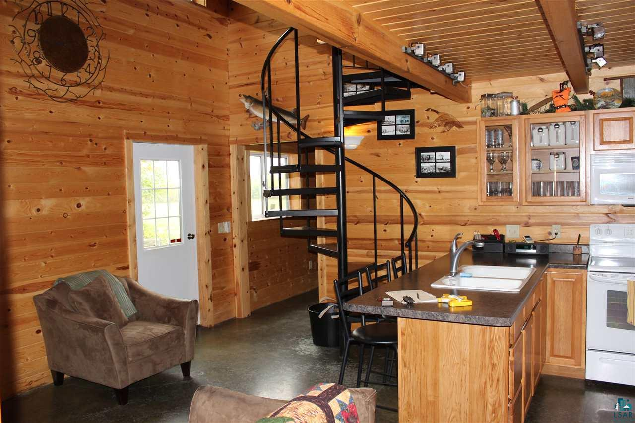 """A OUT DOOR PERSON'S/ FAMILIES DREAM PLACE, 160 WOODED ACRES OVERLOOKING LAKE SUPERIOR, POND IN PLACE, TRAILS CUT IN, AND A NEW MODERN POLE BARN FOR TOY STORAGE, THAT INCLUDES A LIVING QUARTERS THAT SLEEPS 11. MODERN AND CLEAN THROUGH OUT. NOTHING HAS BEEN SPARED. DEPENDING ON THE PRICE A LOT OF """"THINGS CAN BE NEGOTIATED.ON. TWO MILES TO THE NATIONAL FOREST AND SNOWMOBILING AND 4 WHEELING TILL YOUR HEART IS CONTENT, THEN COME HOME TO THE OUTDOOR HOT TUB OVERLOOKING LAKE SUPERIOR..  THIS PLACE IN TRULY TURNKEY."""
