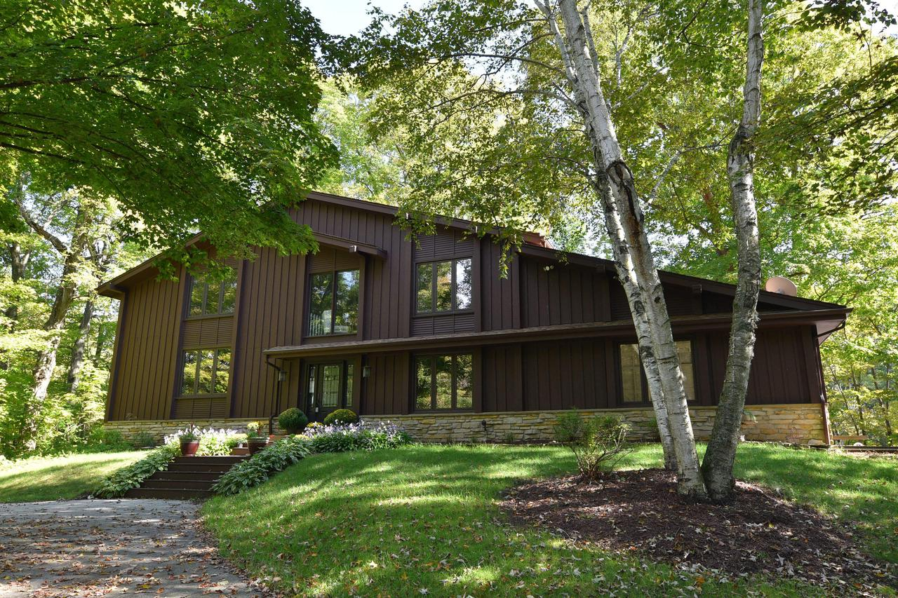 Nestled in the Kettle Moraine countryside you'll find this meticulously maintained, open concept home. The interior boasts a new kitchen, stone countertops, newer mechanicals, new roof, complete tear off, new light fixtures, freshly painted. Ideal entertaining flow with a large great room, from the kitchen and beyond, the views of the cozy stone hearth fireplace and undisturbed woodlands, provide the ideal escape. 2nd floor master ensuite then step out with your coffee and soak up the spectacular vista of birch trees, creek on 10 acres. Could be the perfect vacation home or weekend retreat for cross country skiing or walks in the winter wonderland. A tranquil escape only minutes from shopping and the highway.
