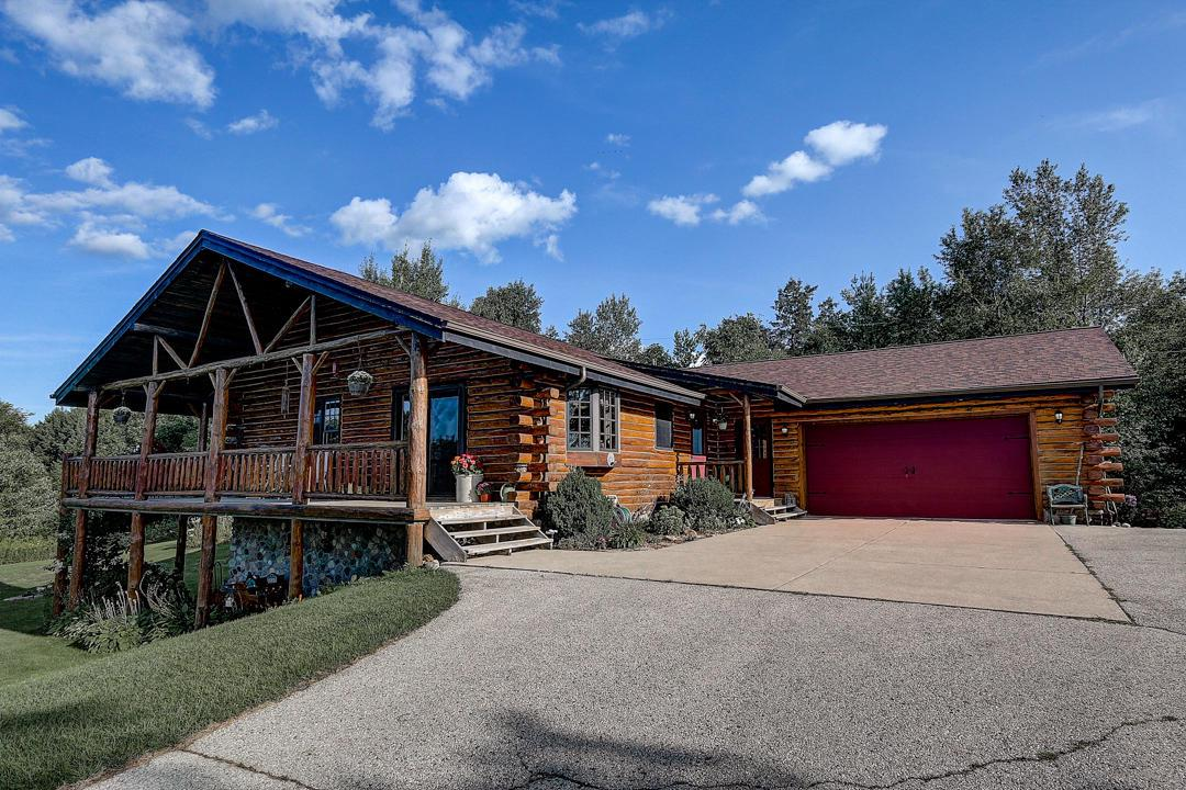 Welcome to ''Shetland Hills'' in the lovely Town of Erin! Incredible views unfold of rolling acres filled with wildflowers, beautiful pine trees & abundant wildlife along the long, winding driveway. At the end, an updated ranch log home sits on top of the hill. This private retreat is the perfect getaway for the peace, seclusion & hunting land you crave! Open concept floor plan features modern updates like Granite kitchen counters with luxury vinyl flooring & updated bathrooms. The walk out basement is ready for your finishing touches to maximize your living space. This 13+ acre Hobby Farm comes complete with a small barn to house sheep & goats, a chicken coop for farm-fresh eggs, and a sizable sheep pasture. Blueprints are available for building your dream pole barn for your horses & toys