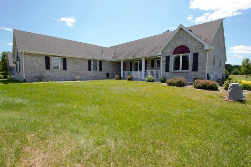3 bedroom all brick ranch on 7 acres and backs up to a park preserve! Great room with 2-way gas fireplace. Huge kitchen. Sun room. Master bedroom with walk-in closet Lower level has heated floors! Home is prepped for generator bathtub. 3.5 heated attached garage plus 1500 square foot heated detached garage that could fit 5-6 cars. Great for the car enthusiast! Circle driveway. Home is not subject to subdivision regulations! Home warranty included!