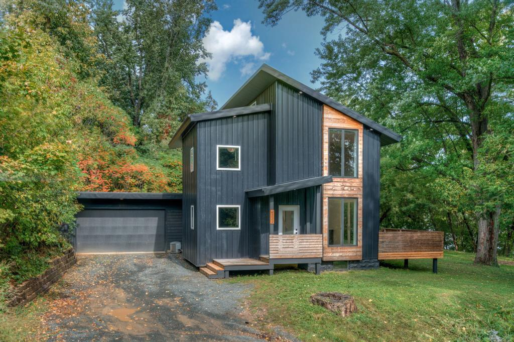 Spectacular contemporary home sitting on a private high lot above Spring Valley! This stunner features hardwood floors, 3 bedrooms, 2 baths, tons of windows and soaring vaults, 2+ car attached garage and a 24x24 detached workshop. You will want to see this one!