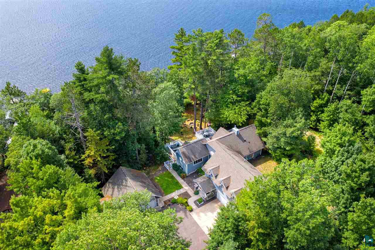 Spectacular home in the truly magical community of Lake Nebagamon. 200 feet of sandy lakeshore with great views over the lake. Custom built home with spectacular finishes that would cost far more to build today than the asking price. 4 car garage which includes a 2 car attached garage and 2 car detached garage separate stair case to a 28 X 40 loft. In pristine condition this home offers wonderful separate finished areas that work great for extended family on three levels. Great location on the lake, lots of frontage, large lot, beautifully finished home, and large outdoor seating areas makes this home a wonderful choice for your next home.