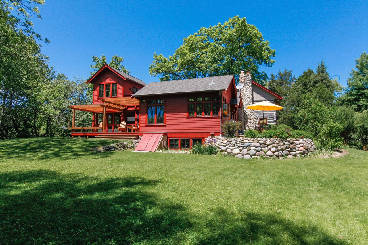 Inspired combination of original 1848 log cabin and 2006 farmhouse addition. If you appreciate character and authentic materials and design, look no further! Highly acclaimed award-winning architect Ross Chapin designed the addition; great use of space and light and views galore! The best of natural surroundings that Erin is known for, this location offers easy access to Loew Lake trails, stunning vistas and wildlife and nature. The original cabin houses the living room with fieldstone fireplace and the 3rd bedroom/family room above. Newer eat-in kitchen with wood, soapstone, large farmhouse windows and stainless appliances.Easy access to the large screen porch and deck. Second floor master and 2nd bedroom, with vaulted ceilings and private master deck. Gorgeous property and amazing house!