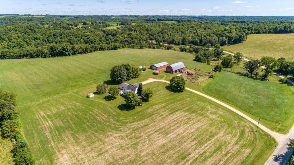 Amazing opportunity to own this 8+ acres hobby farm on a dead end road just 6 miles east of Ellsworth.  Large farm home with over 3000 finished sq ft of living space including large kitchen with center island and spacious dining room.   Main floor master bedroom and laundry.  Full bath on main floor. All new carpet in upper level.  Three nice sized bedrooms upstairs.   Finished rec room space for games, parties, etc.  Attached 2.5 car garage Outbuildings include 36 x 72 pole shed with electricity, 36 x 80 old style barn, chicken coop, grainery and 2 corn cribs.  Endless opportunities for hobby farm, hunting and more.  Don't miss this one!