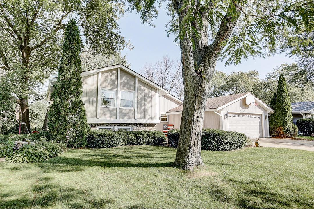 Welcome Home to this spacious multi-level home in a highly sought after New Berlin neighborhood. The main level has vaulted ceilings, an updated kitchen, natural fireplace, & dining room. A few steps up leads to the master suite with walk-in-closet and dual entry full bathroom. Two additional bedrooms complete the upper level. In the lower level there is a family room with wood burning fireplace, laundry room, a 4th bedroom, and a den/craft room. Walk to New Berlin Eisenhower Middle and High School! This peaceful neighborhood with mature trees is the perfect place for your next home. Book your private showing before it's gone. Pictures and Virtual Tour to come!