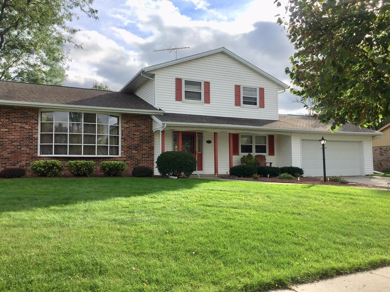 Incredibly well maintained 4 BR home is located close to schools and features a nearly 1/3 acre private yard that is nicely landscaped!  Beautiful updates include newer LWF's in the LR!  FR features a NFP and patio door to backyard patio!  Spacious kitchen has nice cabinets, LWF's, a huge pantry and a nice size dining area with patio door leading to deck with built in benches!  A first floor laundry with door to backyard and a fourth BR/den are also on the main level.  Finished LL Rec Rm is nicely done with recessed lights and built in entertainment area.  Upstairs you'll find a huge MBR w/split style bath/dressing area.  BR2 and BR3 are also nice size!  Garage w/extra doors to the back for easy access for tractor!  Beautiful patio and deck!  Nicely landscaped and updated!  Must see!