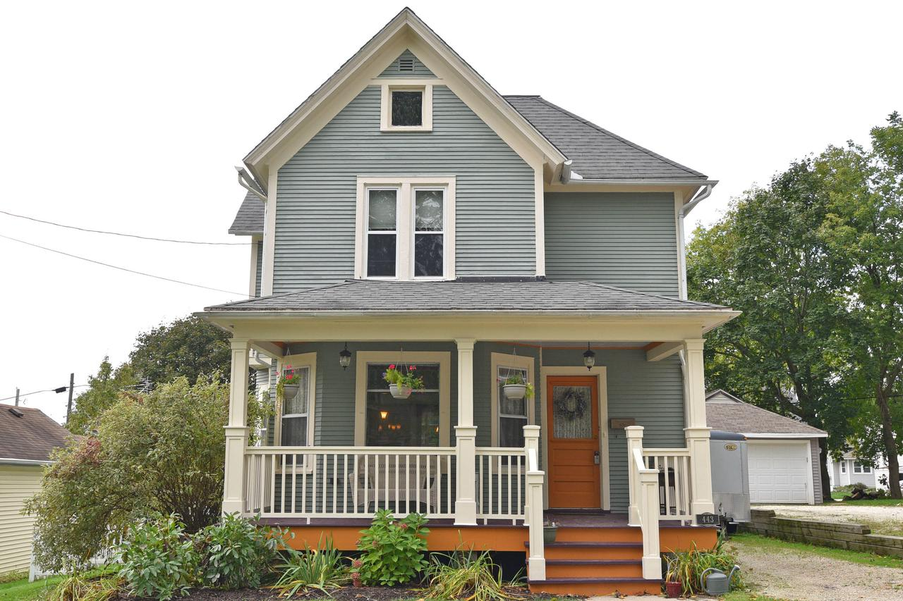 This lovingly restored Victorian will impress you from the moment you pull up to the curb. Many updates have been tastefully done in keeping with the original architecture. Bright rooms throughout, gorgeous hardwood floors, natural woodwork, leaded glass & many newer windows. The rebuilt front porch is perfect for relaxing. Den/office on main level has a full closet. Cozy sunroom & powder room off the updated kitchen with a breakfast bar. Find 3 bedrooms upstairs including spacious master bedroom with huge walk in closet & balcony!  Oversized full bathroom with even more closet space.  Quaint backyard is fully fenced & features a patio. Loads of storage on every level. Amazing walkable neighborhood near several parks & the school. Come see this gem for yourself.