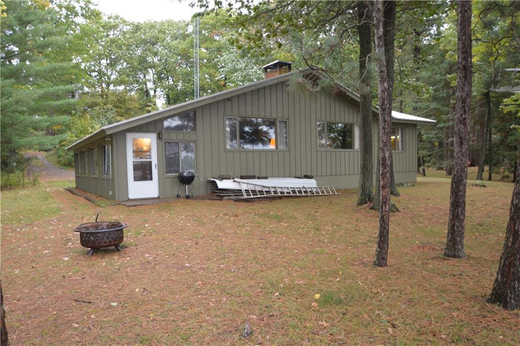 Are you looking for a great spot on Whitefish Lake? This is it with level frontage and sandy beach 1.08 acre lot with 150' of frontage. One owner well cared for 2-bed 1 bath, 4-season cabin/home. 2-car detached heated garage with lean-to. This property comes with dock, boat lift, ice fishing shack, a fish house and a shed for storage.  Double Sided Fireplace (Dual Heat, wood or propane), small free standing wood stove in basement (URL Cert) Whitefish Lake is a 800 acre lake located in Sawyer County. It has a maximum depth of 105 feet. Visitors have access to the lake from a public boat landing. Fish include Musky, Panfish, Largemouth Bass, Smallmouth Bass, Northern Pike, Trout and Walleye.