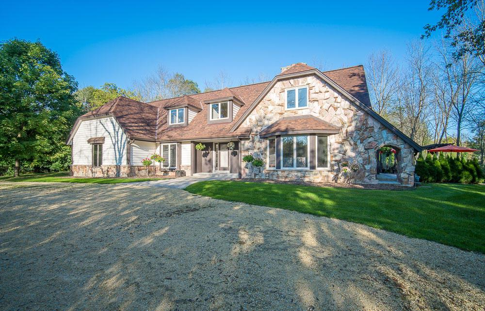 Incredible 3BR 2.5BA Contemporary Home Located on 2.25 Acres w/150Ft of Views of the 3rd Tee Box on Mequon's River Club Golf Course! 2 Story Foyer w/Grand Staircase Welcomes you! French Doors Lead you into DR w/Crown Molding and Chair Rail. The LR Features a Wall of Windows and 2-Way GFP that Gazes Through to FR with Huge Bar Area and Patio Doors out to Amazing Paver Patio w/Views of Golf Course. Great for Entertaining! The Eat-in KIT has Gorgeous Black Walnut Custom Cabinets and Stainless Steel Appliances. Upstairs You'll Find a MBR Retreat w/ Newly Updated Bath and Balcony w/ Incredible Views. Loft Space and 2 More Bedrooms on Upper.  Newer 50 Year Roof w/Gutter Guards and Newly Tuckpointed Chimney + New Carpet and Freshly Painted Inside and Out.  Circle Drive with 3 Car Garage. Hurry!