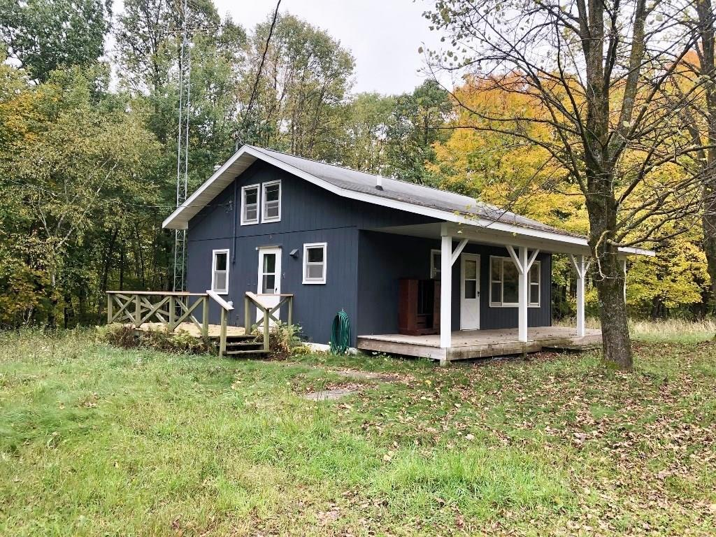 Great location for a cabin - Gandy Dancer Trail, hunting land and Wood River all wrapped up in one. One bedroom with loft and includes lots of updates through out cabin. Oversized garage. Close to town yet secluded.