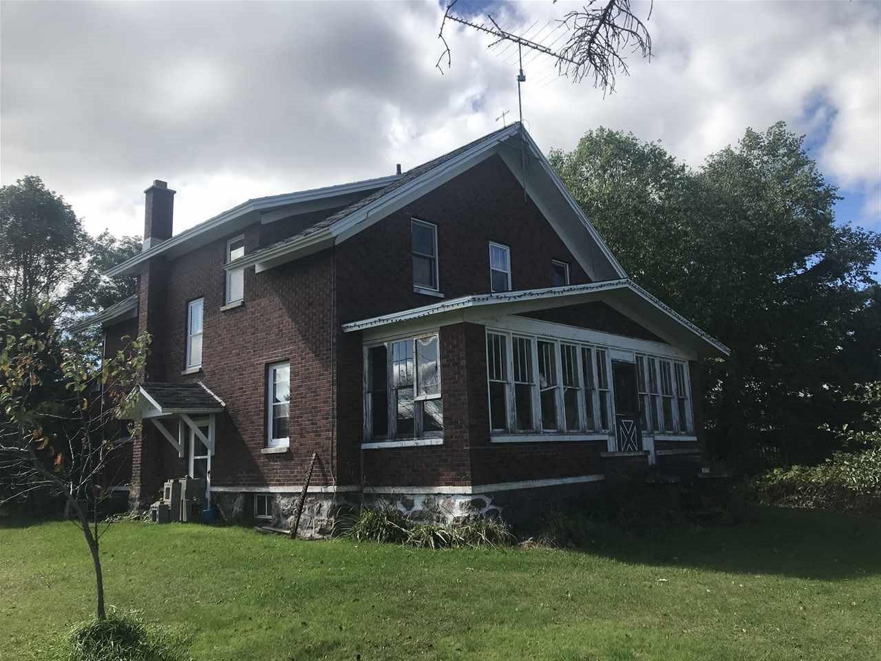 A must see. A nice brick farm house with a lot of character. Hardwood flooring under existing carpeting waiting to be renewed. Large rooms and lots of storage and walk in closets in all the bedrooms. Future bathroom roughed in on the 2nd floor. There is a 40x80 pole shed waiting for storage or to be your shop. There is a large barn in need of a little TLC but perfect for raising horses or cattle with a large concrete slab in the back to fence your animals in. Lots of fruit trees as well as berry bushes.,This is a perfect hobby farm to raise a family and enjoy the beautiful outdoors.