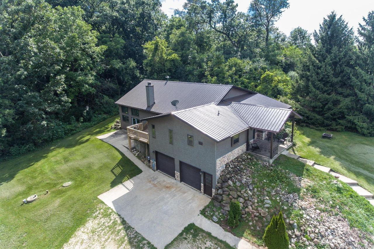 Spacious Custom Home Being Sold By The Original Owners ~ Located On Just Under 5 Partially Wooded Acres, Only 2 Miles From Linn Township Boat Launch & Sandy Beach On Geneva Lake. Open Kitchen & Dining Space + Pantry & Breakfast Bar, Walks Out To Deck. Great Room With Cathedral Ceilings, Stone Fireplace & Swim Spa (Can Be Removed By Seller), Walks Out To Patio. Master Suite With Walk-in Closet & Master Bath ~ Double Vanity, Whirlpool Tub & Walk-in Shower. Loft Makes For A Great Office. Oversized 2 Car Attached Garage. Newer Furnace, Water Heater & Pressure Tank.
