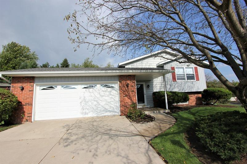Welcome home to this 3 bedroom, 1.5 bathroom bi-level Hartford home located in a tucked away neighborhood only a quarter mile from Hwy 60.  This clean and well-maintained home features pre-engineered flooring and carpet in 2018.  Kitchen features breakfast bar and sleek black modern appliances. Detailed lawn care and curb appeal will impress as you enter the property. Lower level sliding glass doors lead to your patio from the spacious and bright family room. 2.5 garage has ample room on both sides of vehicles, and door to back yard. Garage doors replaced in 2013.  Seller providing $485 HSA home warranty. Furnace & air conditioner 2017. Water heater 2014. Roof 2009.