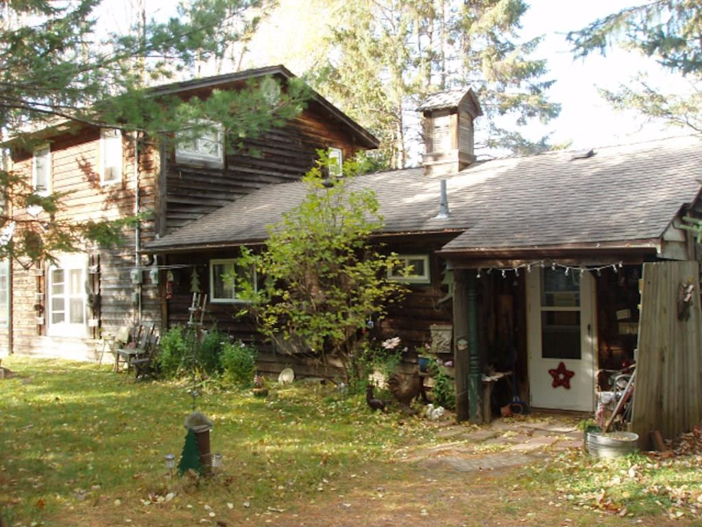 (268) Waterfront living can be yours with this two-bedroom, one bath home on Wintergreen Lake. Bordered by the Chequamegon National Forest this is a great recreational area. Main level has small entrance porch. Kitchen, dining room/sitting room overlooking lake with a free-standing woodstove. The  bath has a shower and linen storage. There is a living room and a small walk-through that could be used for an offer/computer room. The upper level has a large master bedroom with a skylight and a patio door leading to a small deck. There is a screen house down near the lake and a dock. One car garage plus additional storage. Situated 9+/- miles southeast of Park Falls off Hwy. 70 on Deer Lane. See it today! $119,900 (36-40N-1E)