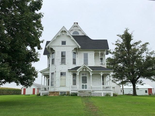 Bring this historic farmette on 9 acres back to its original beauty! Interior offers high ceilings, intricate wood built-ins, trim, fireplace, and staircase. Per seller, approx. 3 of the 9 acres are tillable, w/ 3 out buildings and barn. Roof is 1 year old, furnace is 2 years old. Second floor is not being used, needs TLC, and is not hooked up to the furnace at this time. Property is being sold AS IS. DO NOT rely on MLS info. Buyer to rely on their own inspections etc. Zoned AG, check financing requirements. If the cooperating agent/broker are not members of the Rock Green MLS or SCWMLS, compensation is 2.4% to subagents and buyers agents.