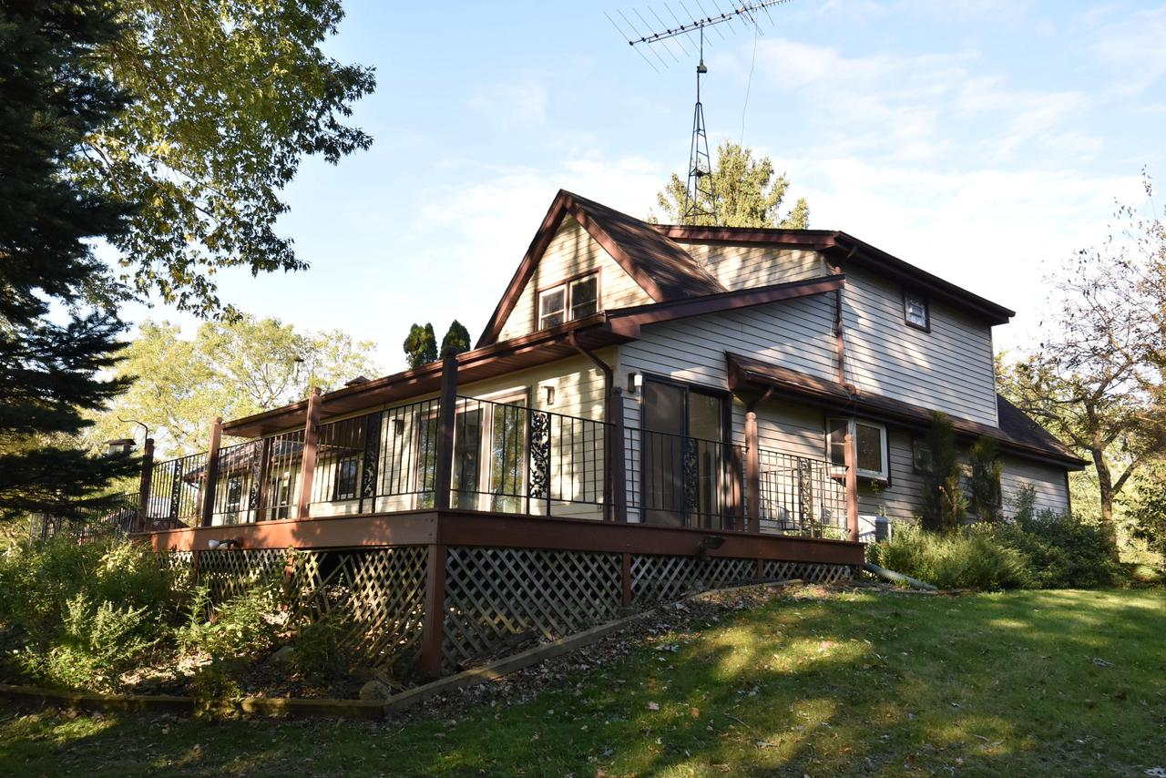 RARE OPPORTUNITY to Live on the Lake! 280ft of frontage on Lake Raymar, a private, quiet, no-wake 5+ acre lake offering great fishing and family fun. Custom Built  4BR,, 3BA  Cape Cod with patio, deck, attached 2.5 car garage plus a detached 1 car garage or shed. An Open Concept floor plan GREAT ROOM/KITCHEN with a Wall of Windows offering a spectacular view of the lake, Ben Franklin stove, cabinetry and counter space galore.  4 Spacious BRs with 2 on the main flr have plenty of closet space and HWFs under carpet. Main flr laundry, Lower level RecRm.... Must see to appreciate all this property has to offer!