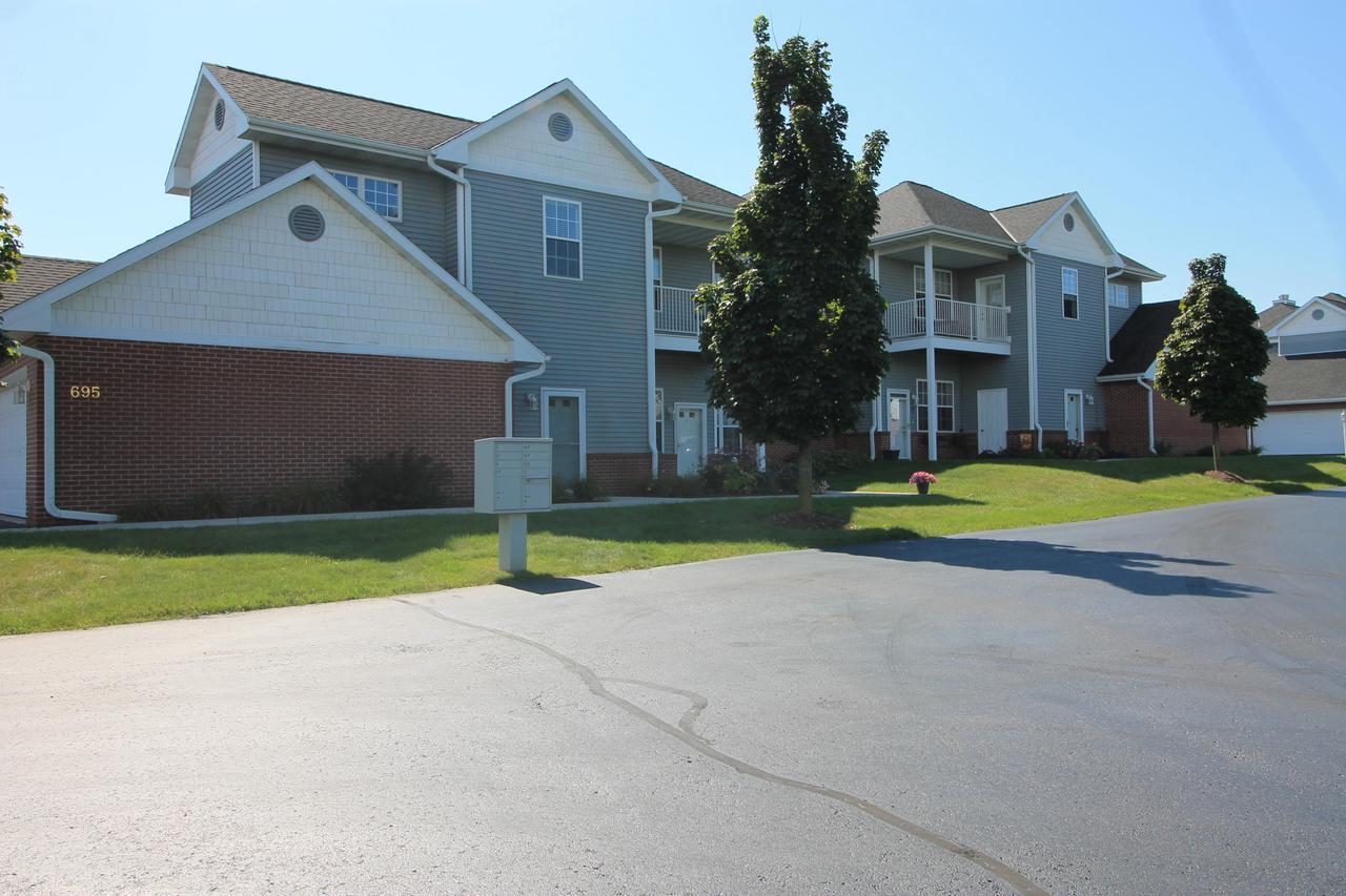 Amazingly well cared for upper unit in Park Place Condos now available & move in ready for the new owner! Bright entry & open staircase welcomes you to the spacious living spaces. Newer appliances, solid wood cabinets, & large peninsula style seated island highlight the very functional eat-in Kitchen. Generous Great Room with an abundance of south-facing windows & beautiful gas fireplace for those cold winter days! Large Master Bedroom suite with window seat, oversized walk-in closet, & fantastic bathroom with separate walk-in shower & whirlpool  tub! Spacious 2nd Bedroom, full bath, Laundry Room, & extremely coveted bonus Den/TV room complete the interior of this awesome floor plan. Private, south facing balcony overlooking green space perfect for sipping morning coffee! Call today!