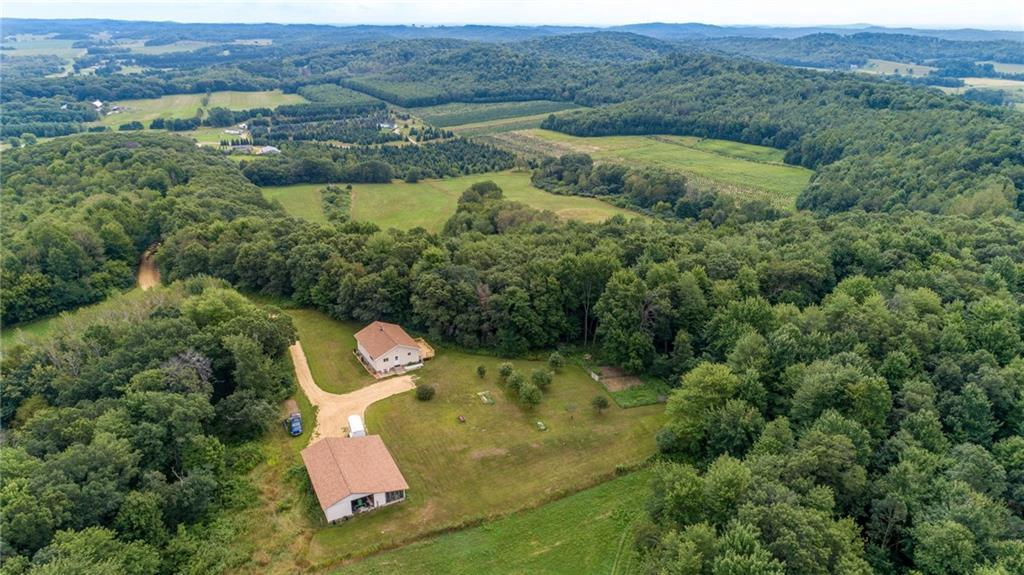 Secluded! 52 acre organic hobby farm is just waiting for you! 4 fields for pasture, crops, hay etc. Beautiful backdrop of mature trees.  Outbuilding has several areas: Garage 24x30, Horses 24x18, Storage 14x16m Tack Room 8x14, chicken Coop/shop area 14x16. 4 small animal pens 30x40. Watch for lots of wildlife on the  newly graveled driveway to 4 bed, 2 bath home w/ south facing deck and all redone hardwood floors. . Hoffman Hills  backs up to property for your outdoor pleasure.