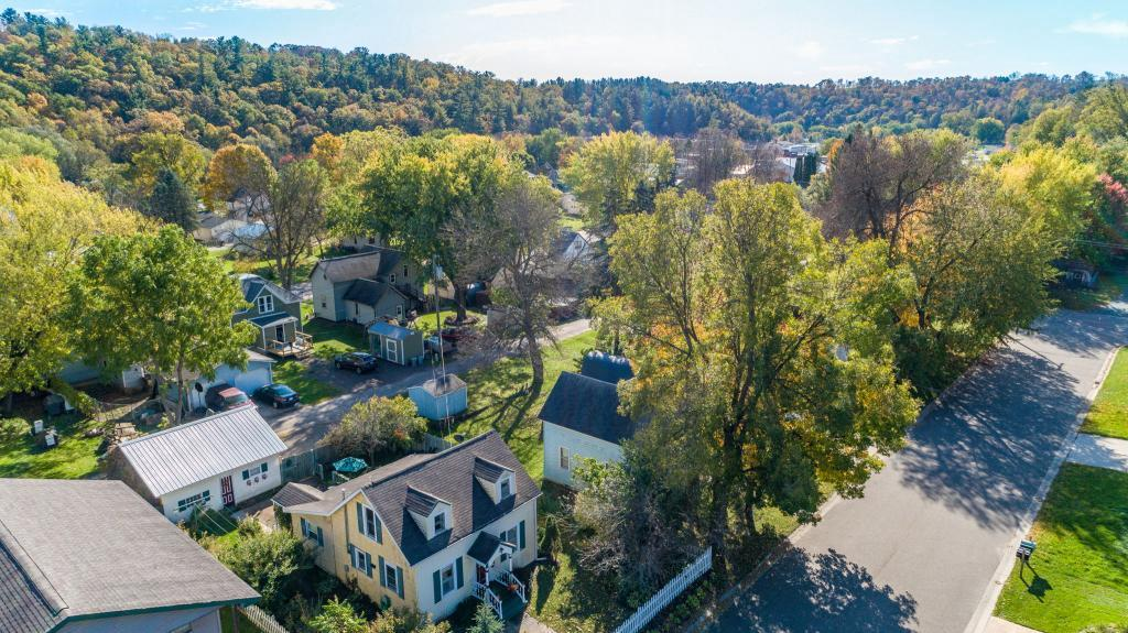 Perfectly adorable 1 1/2 story home in Spring Valley! You'll love the picket fence, private patio, large formal dining room and main floor laundry. Cute as can be!