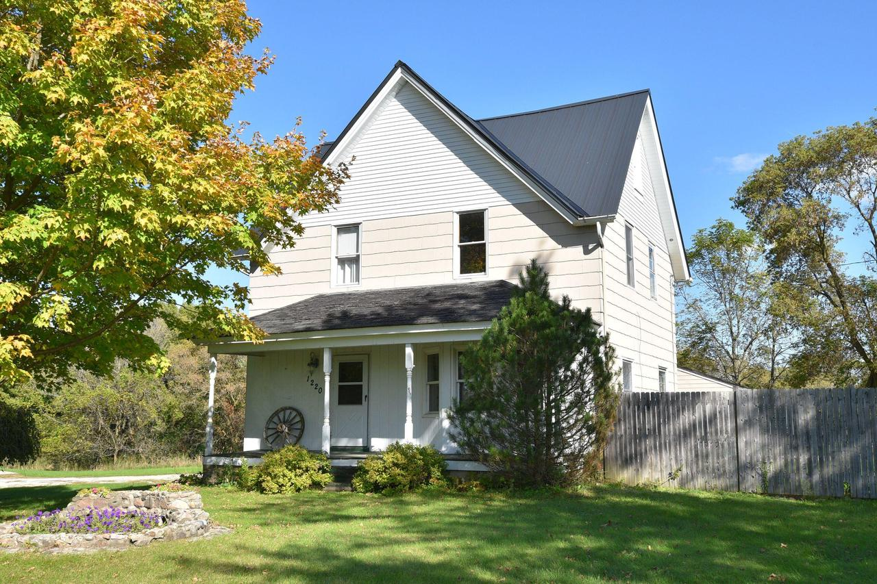 Looking for a project worthy of your sweat equity? This property offers tremendous potential for a great return on your investment. Or are you a savvy rehabber looking for a winter project? Get this home ready for the robust 2020 Spring market! Great farmhouse near Holy Hill with 2 car garage plus a 33'x33' outbuilding/workshop with 10 ft overhead doors, separate gas service, 220 electric outlets, vented for furnace.  The charming farmhouse is sun-filled, with open floor plan, hardwood floors, open staircase, main floor laundry, nice sized bedrooms with ample closets, additional 336 square feet in studded & insulated attic family room.  Large private backyard is completely fenced, with a dog kennel, patio & fire pit.  Updates include Furnace, some windows,  metal roof.
