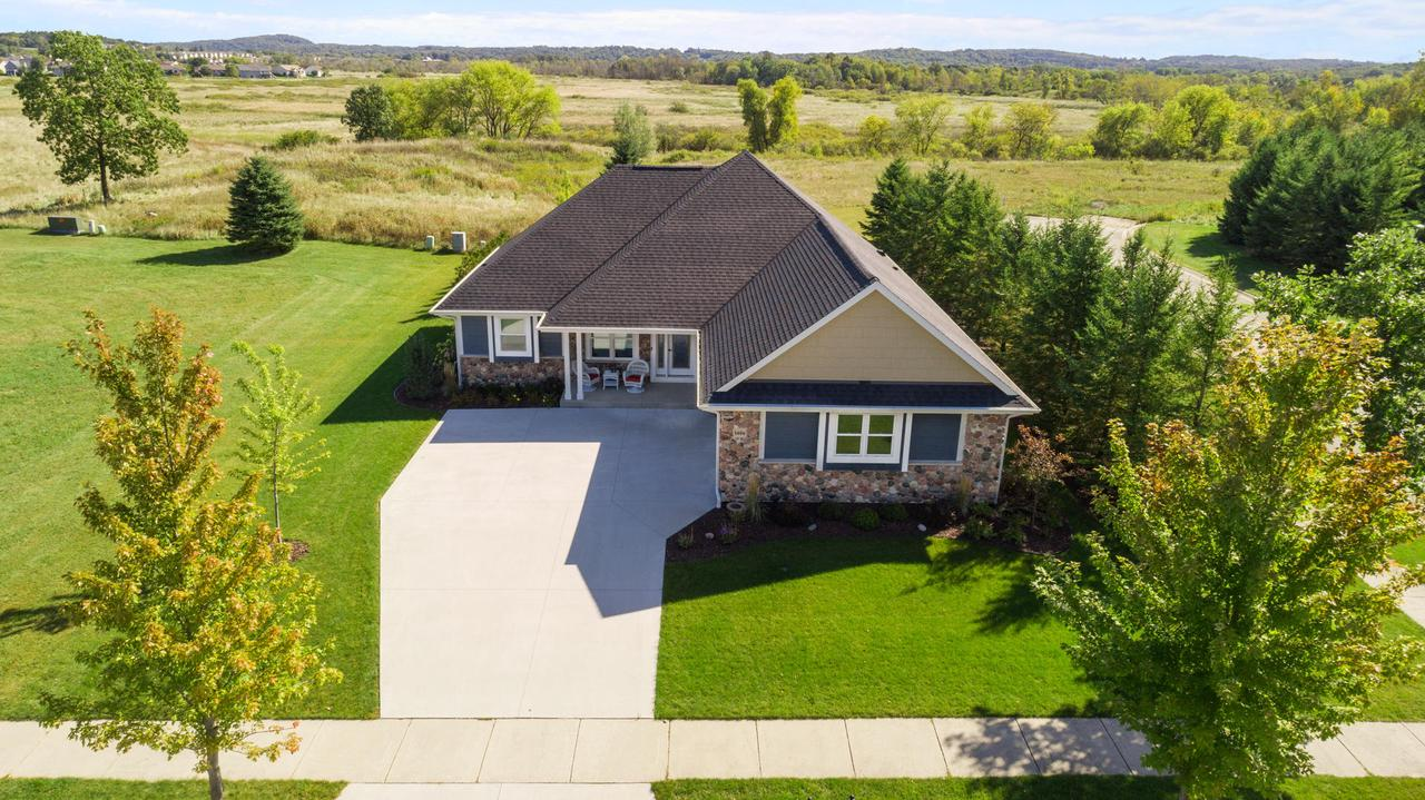 Meticulous in every way describes this 4 bedroom, 3 full bath Ranch home. Newly constructed with quality features from a popular local builder. 3 bedrooms on the main floor with 2 full baths. Open kitchen/ living room with all of the amenities. 2 fireplaces. High end finishes throughout. Large mud/laundry room off the garage access. Open stairway to the finished lower level.  Egress windows lend plenty of natural light. Full bath and large bedroom also in the LL. Cozy front porch with Western sunsets. Lovely patio situated in the private backyard area with a waterfall feature for relaxing evenings. Call for a private showing, sure to be impressed!