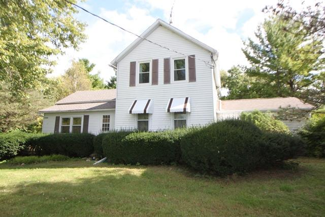 Looking for that special place?  Look no further! This Farm home nestled on 5 acres offers 3 bedrooms and 2 baths.  This home features a newer roof. Beautiful barn, separate dog kennel, and run in shed also included. Apple and Pear orchard too! it's the ideal set up and offers so many possibilities!