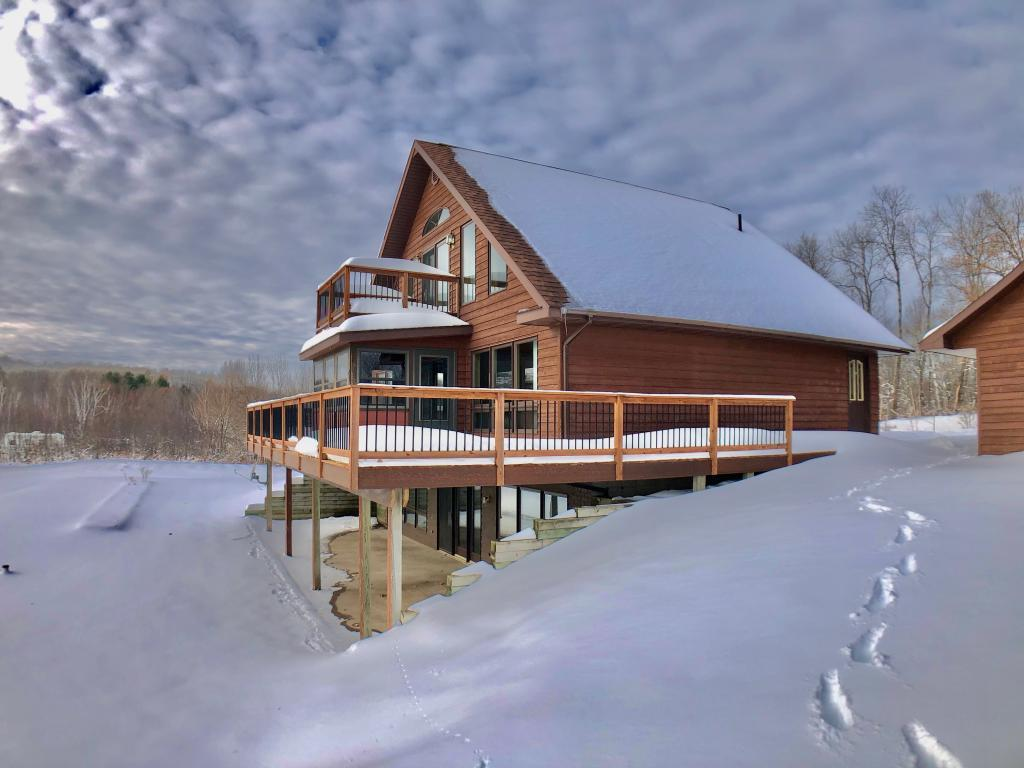 ? Miller Lake ? Get ready to enjoy the outdoors!  This beautiful cedar chalet sits on 1.86 acres and 187 ft of frontage w/plenty of room to add a pole building.  Home features 3 BR, 2.5 BA, open loft with catwalk to a private deck for viewing the outdoors, 3 season porch off the main level for additional enjoyment, pine tongue & groove interior, full walkout lower level with large family room and 2nd kitchen for entertaining, a bath on each level, and a 26 x 36 garage with workshop.  Central air and dock included.  ATV/Snowmobile corridor nearby.  This one won?t last long!