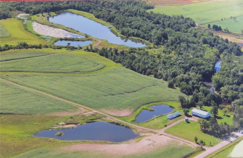 Truly a one of a kind property! 147 acres w/ about 64 acres of quality tillable ground, 16+ acres of beautiful ponds as former gravel pits (some over 20 ft deep), & 2,000 ft of frontage on the Yellow River! 40'x80' fully cemented pole shed with 17ft sidewalls, 5-14ft tall sliding doors, and the start of a campsite shower house inside and living quarters above. 1993 2 bedroom 2 bath mobile home. Looking for an exceptional location worthy of putting your beautiful new home? Your search is over!