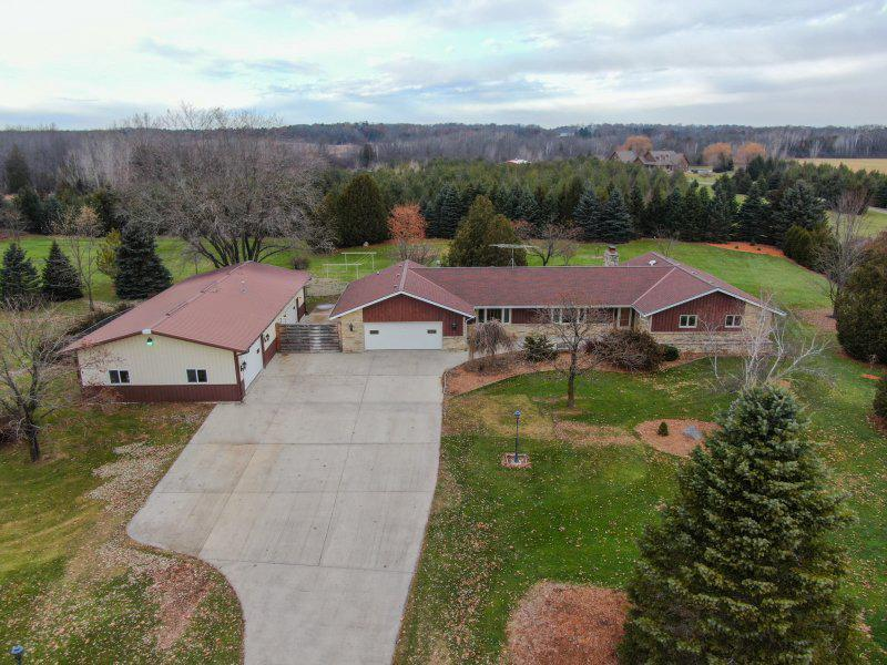7.39 acres with endless possibilities!  Private location with 4 horses allowed.  Updated & move in ready with all modern conveniences & superior floor plan.  Sprawling lannon stone ranch, very well maintained (see features sheet). Newer dream kitchen with custom drawers, island, layout & top of the line appliances.  Open concept design with patio door to private open space viewing wildlife galore.  Newer tile baths with oversized shower, whirlpool tub, cabinetry and flooring.  Large master suite w/WIC.  Room for office on main floor, 1st floor custom laundry.  Storage everywhere.  Lower is ready for updates but holds many possibilities including 5th BR, office, playroom.  Wet bar & wood storage.  Newer windows, doors & flooring, freshly painted. 64x30 outbuilding with heat, water & 220.